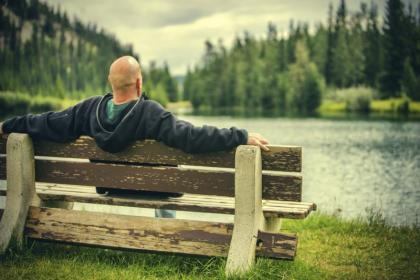 Renal patient relaxing by water.